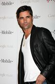 LOS ANGELES - NOV 16:  John Stamos arrives at the Google Music Launch at Mr. Brainwash Studio on Nov