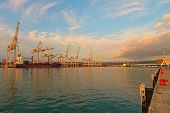 Wide Angle Landscape View Of International Cargo Harbor Of Koper. Empty Container Ship Wait For Load poster