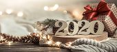 Background Festive New Year Background With 2020 Numbers On Wooden Background . With Lights And Deco poster