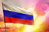 Fluttering Russia Flag On Beautiful Colorful Sunset Or Sunrise Background. Russia Success And Happin poster