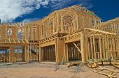 stock photo of 2x4  - Outside view of a two story house construction - JPG