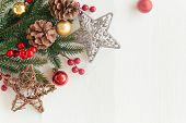 Christmas White Wood With Pine Cones Or Conifer Cone, Red Holly Balls, Glitter Star And Bauble In Ch poster