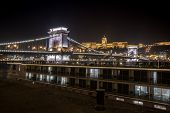 Night View Of The Szechenyi Chain Bridge Is A Suspension Bridge That Spans The River Danube Between poster