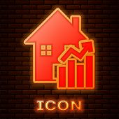 Glowing Neon Rising Cost Of Housing Icon Isolated On Brick Wall Background. Rising Price Of Real Est poster