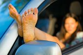 Seductive Woman Having Exposed Bare Feet Out Of Car Window, Focus On Sole poster