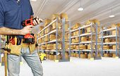 stock photo of argo  - worker in warehouse detail on tools - JPG