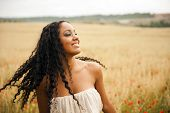 pic of mixed race  - Young beautiful woman outdoors - JPG
