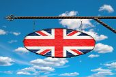 Britain Flag On A Signboard. Oval Signboard Colors Flag Britain Hangs On A Metal Forged Structure. T poster