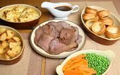 Sunday roast beef dinner in serving dishes