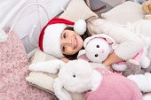 Make A Wish, Say Good Night. Happy Child Go To Sleep On Christmas Eve. Little Girl Cuddle Toys In Be poster