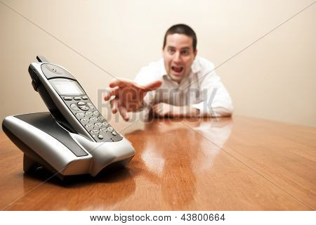Crazy Man Reaching For The Phone