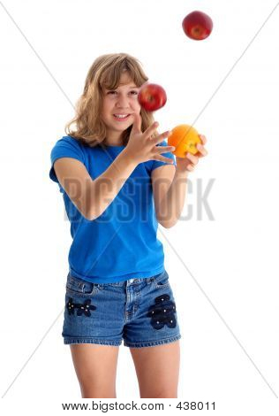 Teen Juggling Apple And Orange