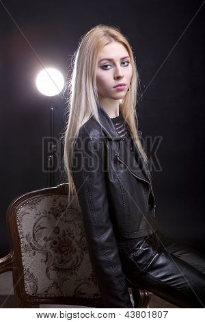 Gorgeous Blonde On A Vintage Chair With A Light Behind