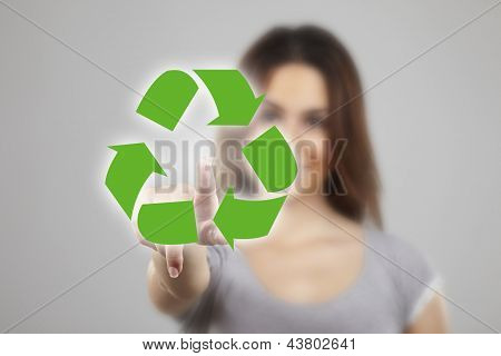 Young Woman Pressing Recycle Icons Over White Background