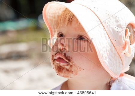 Little Girl Eating Chocolate
