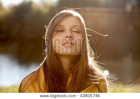 Young Beautiful Woman With Closed Eyes