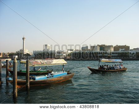 Abra boats crossing Dubai creek between Bur Dubai and Deira in Dubai, UAE.