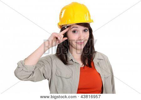 Tradeswoman giving a salute
