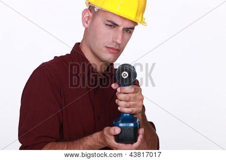 Tradesman aiming his power tool