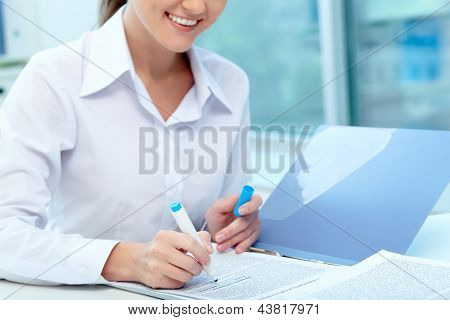 Close-up of young female writing proficiency test