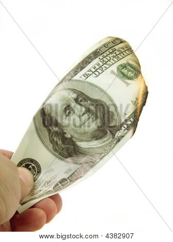 Hand With Burning Dollar