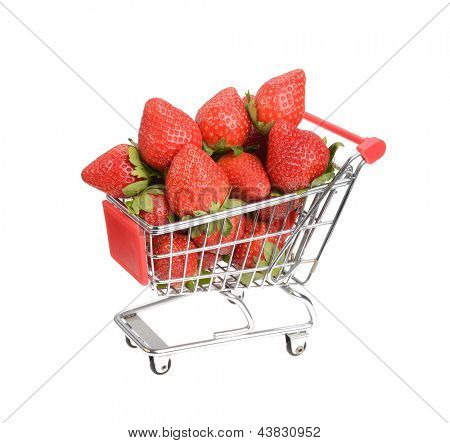 Shopping cart filled with fresh strawberries isolated over white