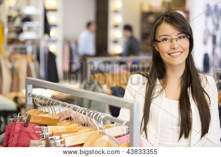 Beautiful casual woman shopping at a retail store