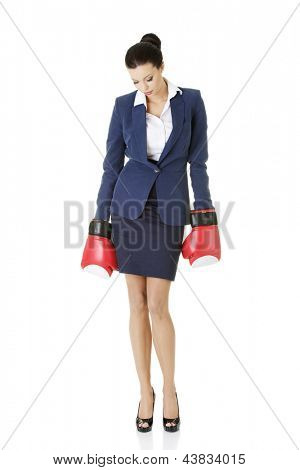 Defeated businesswoman in boxing gloves, isolated on white