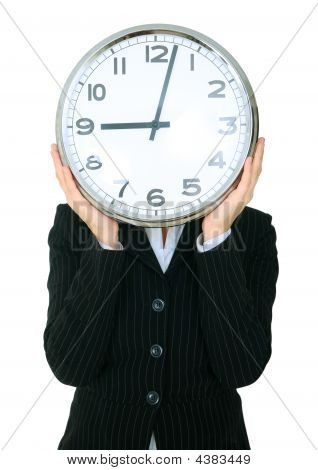 Businesswoman Covering Head With Clock Show 9