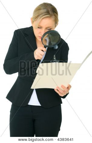 Female Caucasian Investigate A Folder
