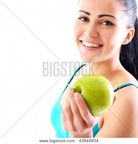Young happy attractive woman holding green apple and smiling and offer if for you, over white