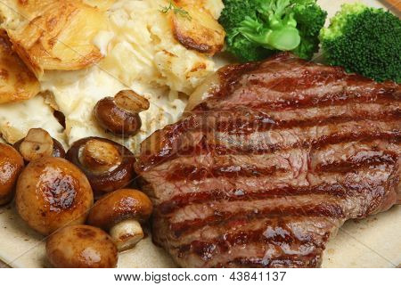 Sirloin steak with dauphinois potatoes, mushrooms and broccoli.