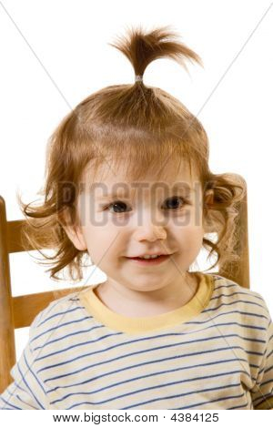Portrait Of Funny Looking Baby Boy With Long Hair