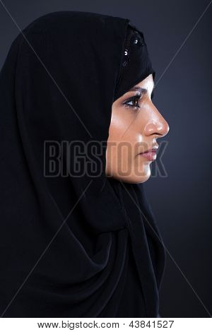beautiful middle eastern woman headshot on black background