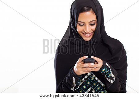 pretty modern Arabic woman playing on smart phone isolated on white