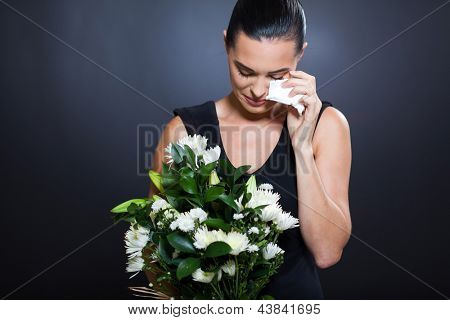 sad young woman in mourning clothes and crying