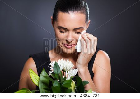 sad crying woman at funeral
