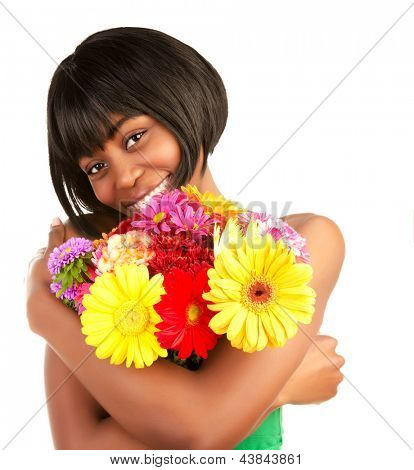 Happy cute black female enjoying romantic fresh flowers bouquet, spring time, isolated on white background