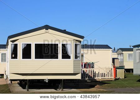 Washing outside trailer in caravan park, Scarborough, England.