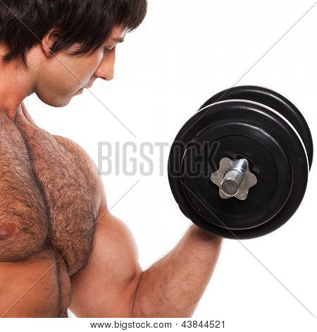 Closeup image of young man with dumbbell on a white background