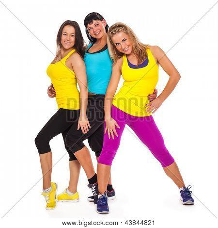 Beautiful happy women in fitness wear on a white background