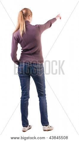 Back view pointing woman. beautiful blonde  girl in jeans. girl in sweater and sandals considering something far. Rear view people collection. backside view of person.  Isolated over white background
