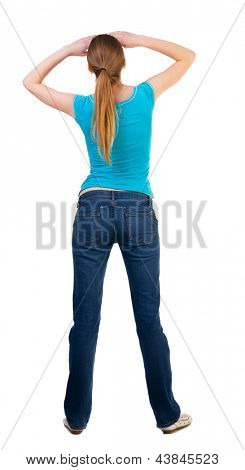back view standing young beautiful  blonde woman. she looks away from her hands covering her eyes light. girl  watching Rear view people collection. backside view person Isolated over white background