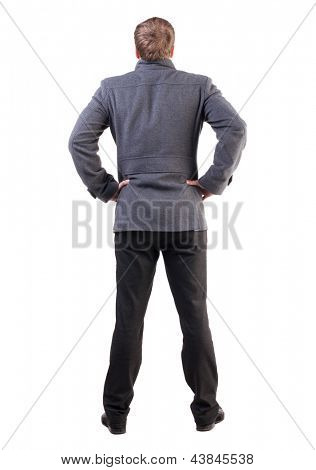 Back view of handsome business man in coat.  man shows confidence. Standing young businessman.  Rear view people collection.  backside view of person.  Isolated over white background.
