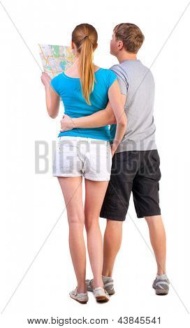 Back view journey of young couple looking at map. travelers man and woman Rear view people collection. couple in summer clothes travel.  backside view person. Isolated over white background
