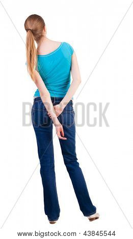 back view of standing young beautiful  blonde woman . she shyly looks at something. girl  watching. Rear view people collection.  backside view of person.  Isolated over white background.