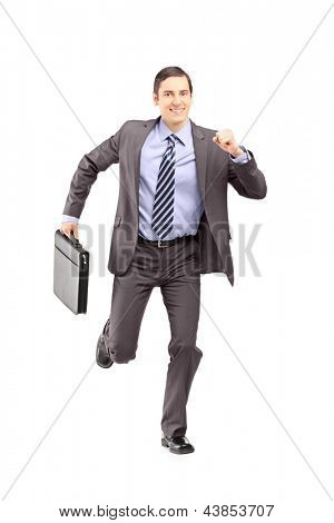 Full length portrait of a businessman running with a briefcase and looking at camera isolated on white background
