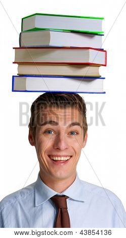 Happy young man holding books over his head.