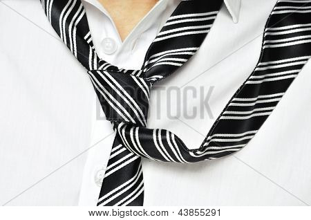 a man with his shirt and his tie loosened