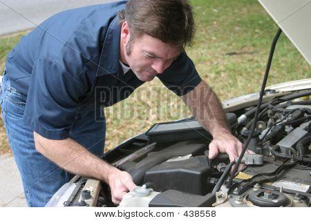 Auto Mechanic Checks Engine